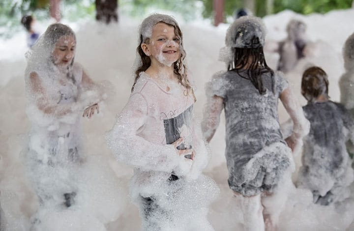 children playing in bubbles