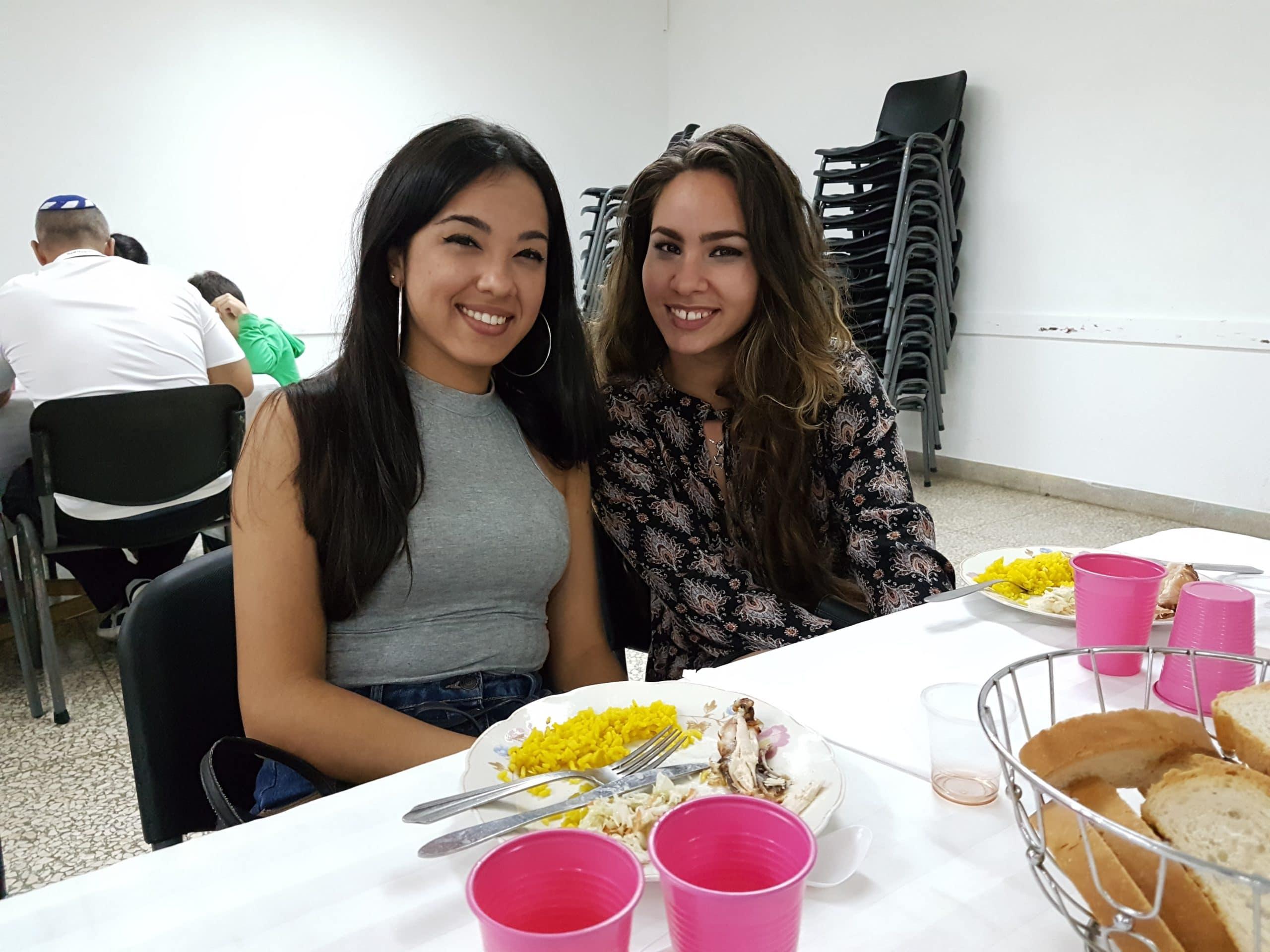 two teenage girls at Shabbat dinner in Havana, Cuba