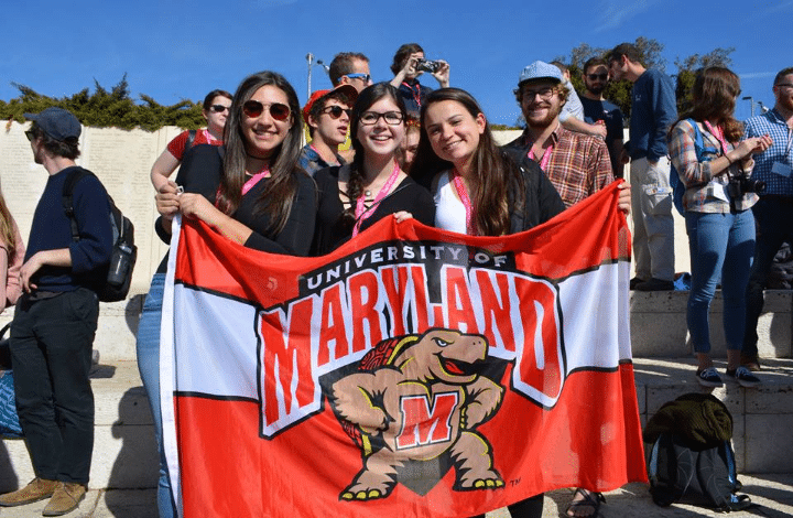 University of Maryland Hillel students holding UMD flag