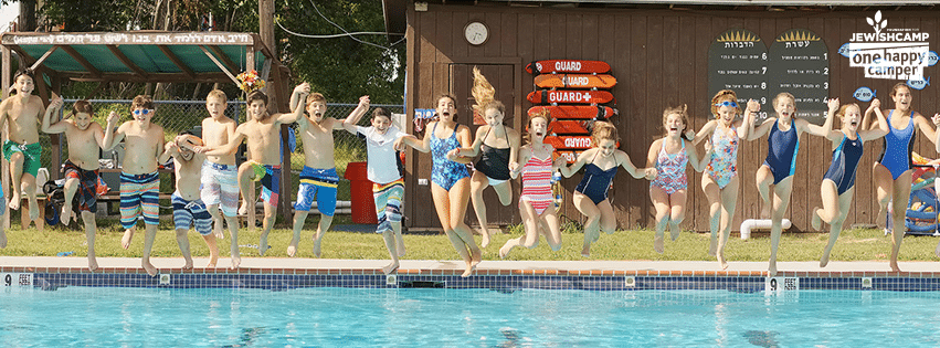 One Happy Camper banner of children jumping into pool